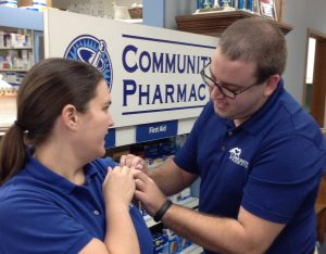 Pharmacist immunizing patient